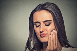 Wisdom Teeth Scarborough - Woman with sensitive toothache crown problem