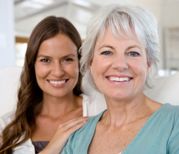 Dr. Amir Awadalla at Esquire Dental Center, Portrait of smiling mother and daughter