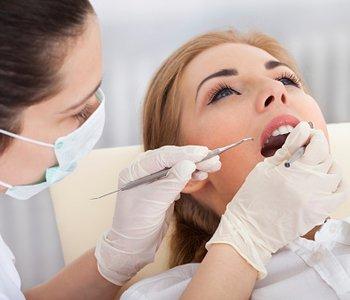 Dr. Amir Awadalla at Esquire Dental Center, Young Woman Having Dental Checkup